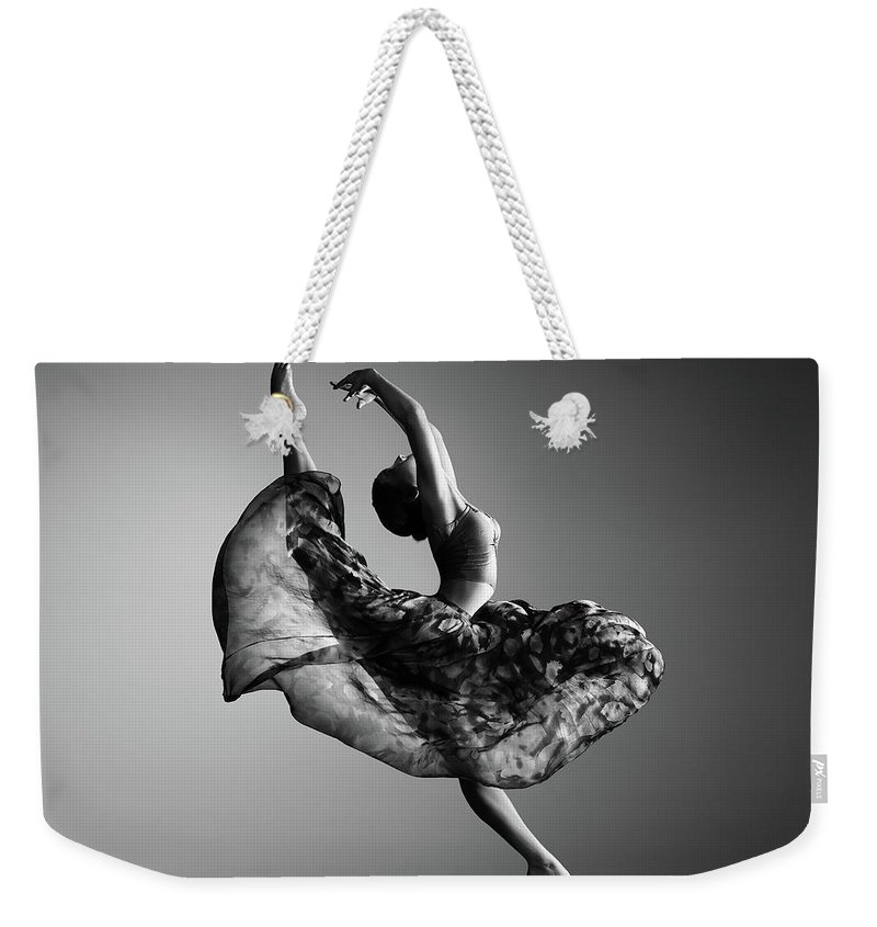 Ballerina Weekender Tote Bag featuring the photograph Ballerina Jumping by Johan Swanepoel