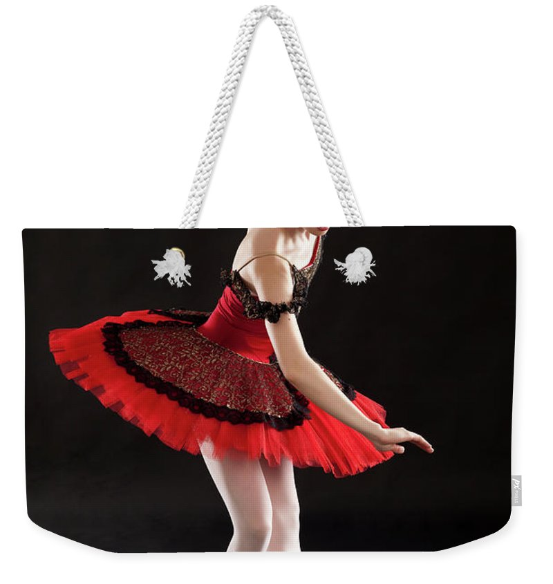 Ballet Dancer Weekender Tote Bag featuring the photograph Ballerina On Point by Rollover