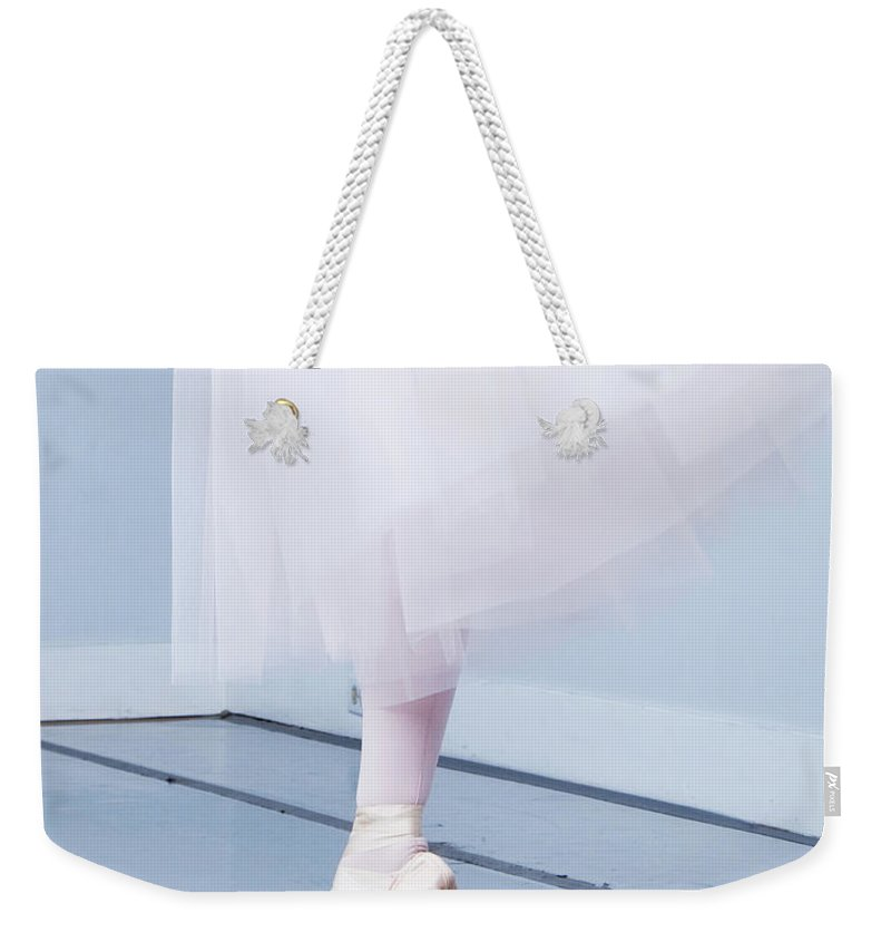 Expertise Weekender Tote Bag featuring the photograph Ballerina On Pointe Low Angle View by Jonya