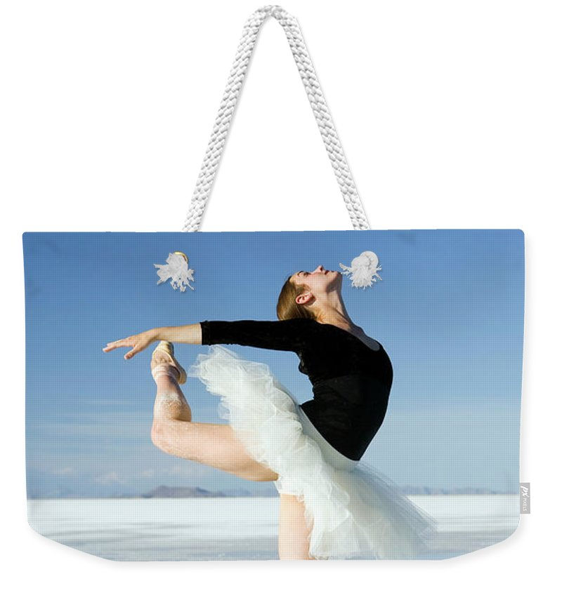 Ballet Dancer Weekender Tote Bag featuring the photograph Ballerina Tip Toe Pose by Avid creative