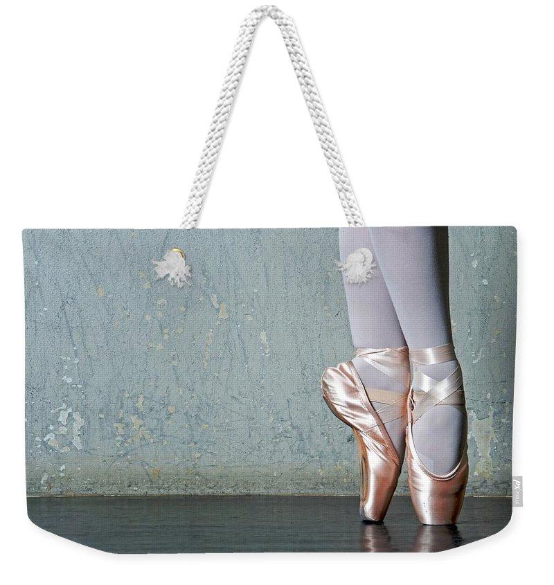 Ballet Dancer Weekender Tote Bag featuring the photograph Ballet Dancers Feet En Pointe by Dlewis33