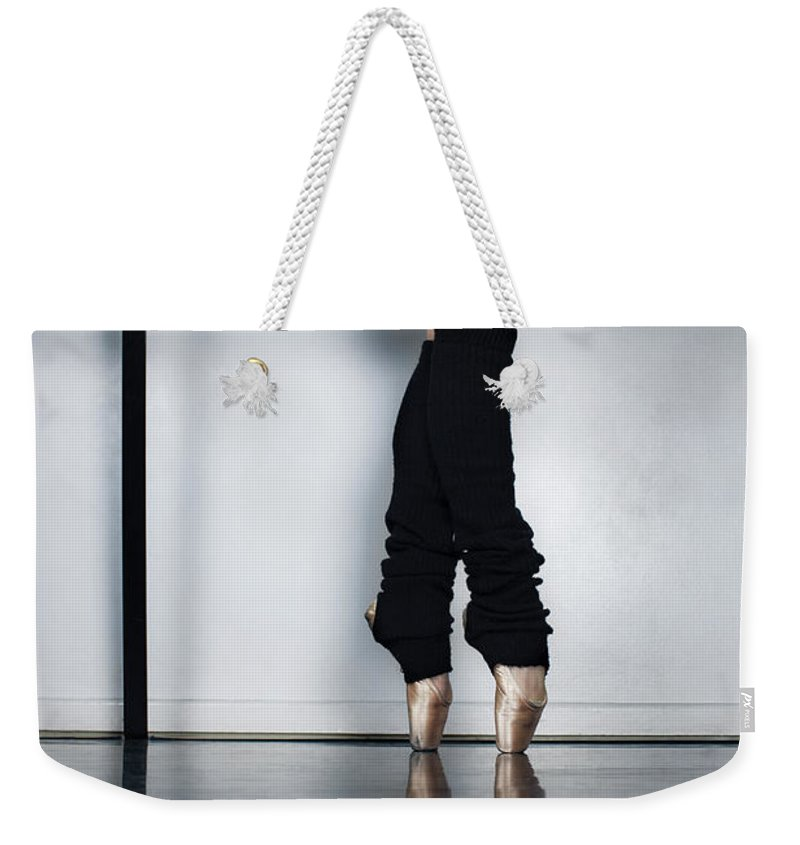 Ballet Dancer Weekender Tote Bag featuring the photograph Ballet Holdiing Bar In Classic Pointe by Patrik Giardino