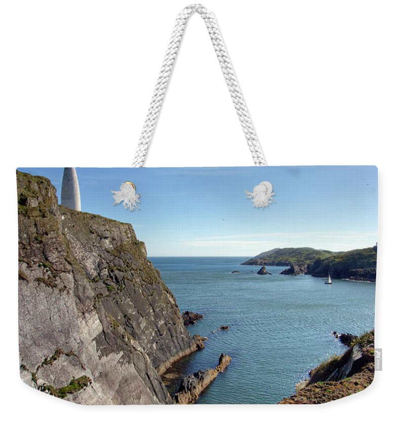 Tranquility Weekender Tote Bag featuring the photograph Baltimore Beacon by Keith Marshall