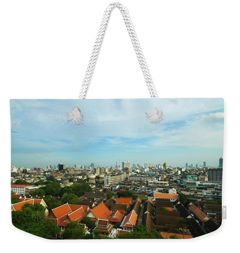 Tropical Tree Weekender Tote Bag featuring the photograph Bangkok View With Temple Roofs 2 by Sndrk