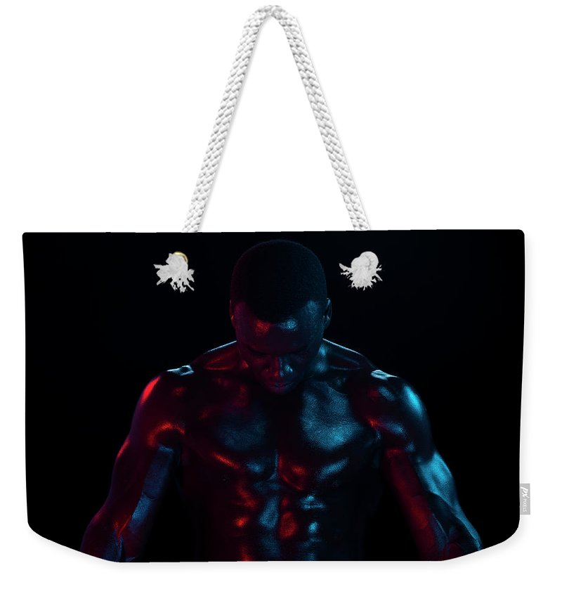 Toughness Weekender Tote Bag featuring the photograph Bare Chested Athlete, Arms Extended by Jonathan Knowles