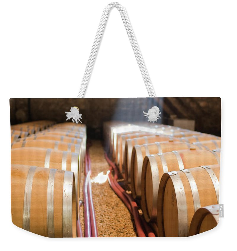 Alcohol Weekender Tote Bag featuring the photograph Barrels In Wine Cellar by Johner Images