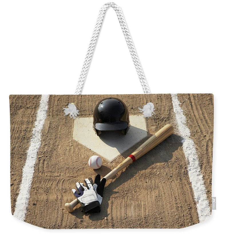 Shadow Weekender Tote Bag featuring the photograph Baseball, Bat, Batting Gloves And by Thomas Northcut