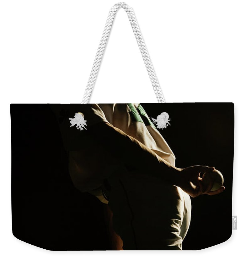 Three Quarter Length Weekender Tote Bag featuring the photograph Baseball Pitcher Holding Ball Behind by Pm Images