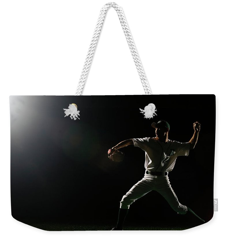 Human Arm Weekender Tote Bag featuring the photograph Baseball Pitcher Releasing Ball by Pm Images