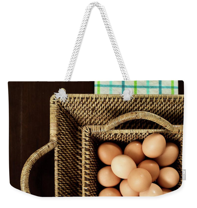 Large Group Of Objects Weekender Tote Bag featuring the photograph Basket Of Brown Eggs by Joey Celis
