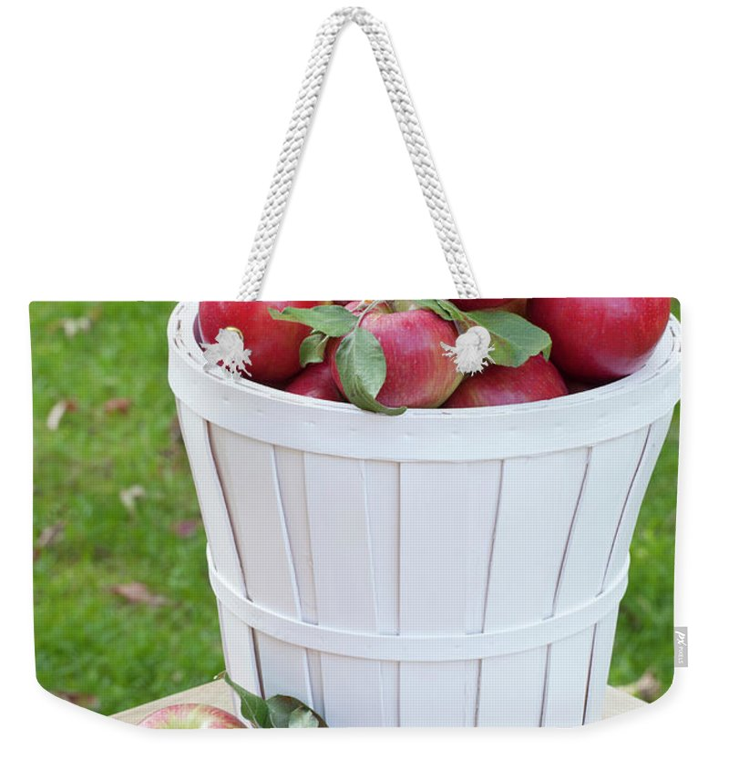 Outdoors Weekender Tote Bag featuring the photograph Basket Of Honey Crisp Apples by Wholden
