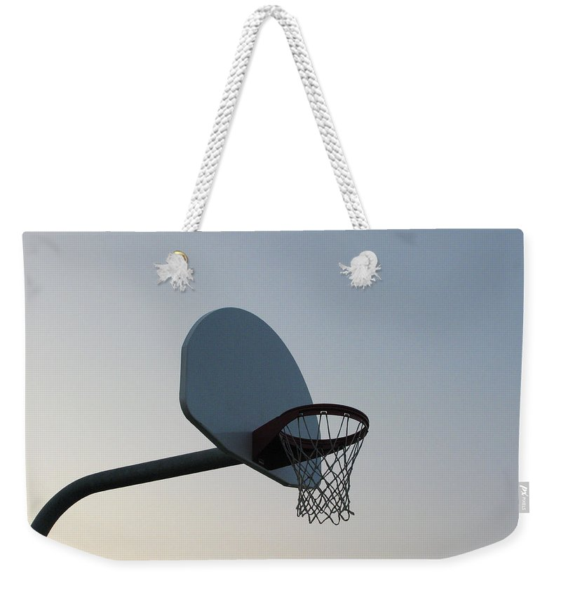 Clear Sky Weekender Tote Bag featuring the photograph Basketball Equipment by Nicholas Eveleigh
