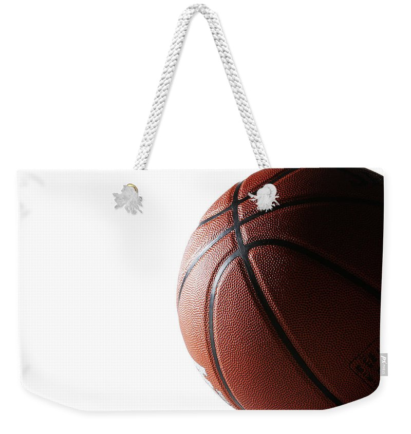 Recreational Pursuit Weekender Tote Bag featuring the photograph Basketball On White Background by Thomas Northcut