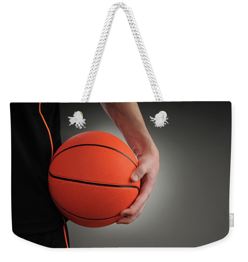People Weekender Tote Bag featuring the photograph Basketball Player by Mumininan