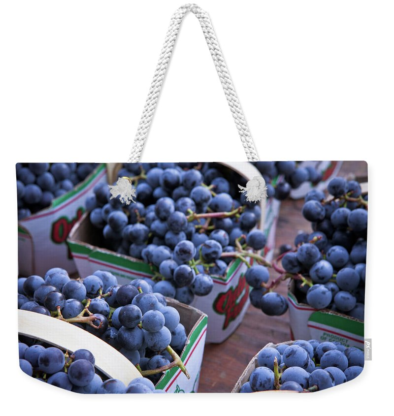 Toronto Weekender Tote Bag featuring the photograph Baskets Of Grapes by Mary Smyth