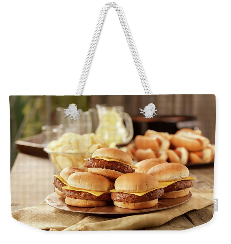 Cheese Weekender Tote Bag featuring the photograph Bbq Cheese Burgers At A Picnic by Lauripatterson