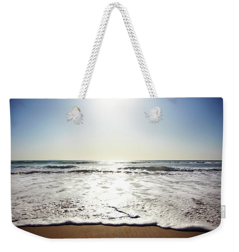 Tranquility Weekender Tote Bag featuring the photograph Beach In California On Pacific Ocean by Thomas Northcut