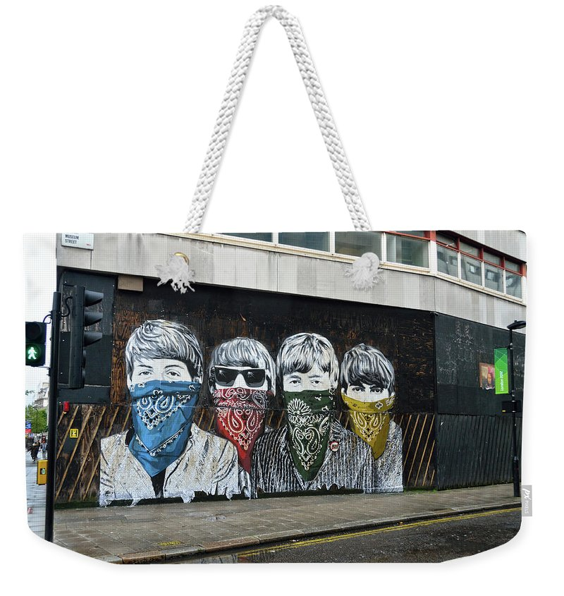 Bansky Weekender Tote Bag featuring the photograph Yhe Beatles wearing face masks street mural in London by RicardMN Photography