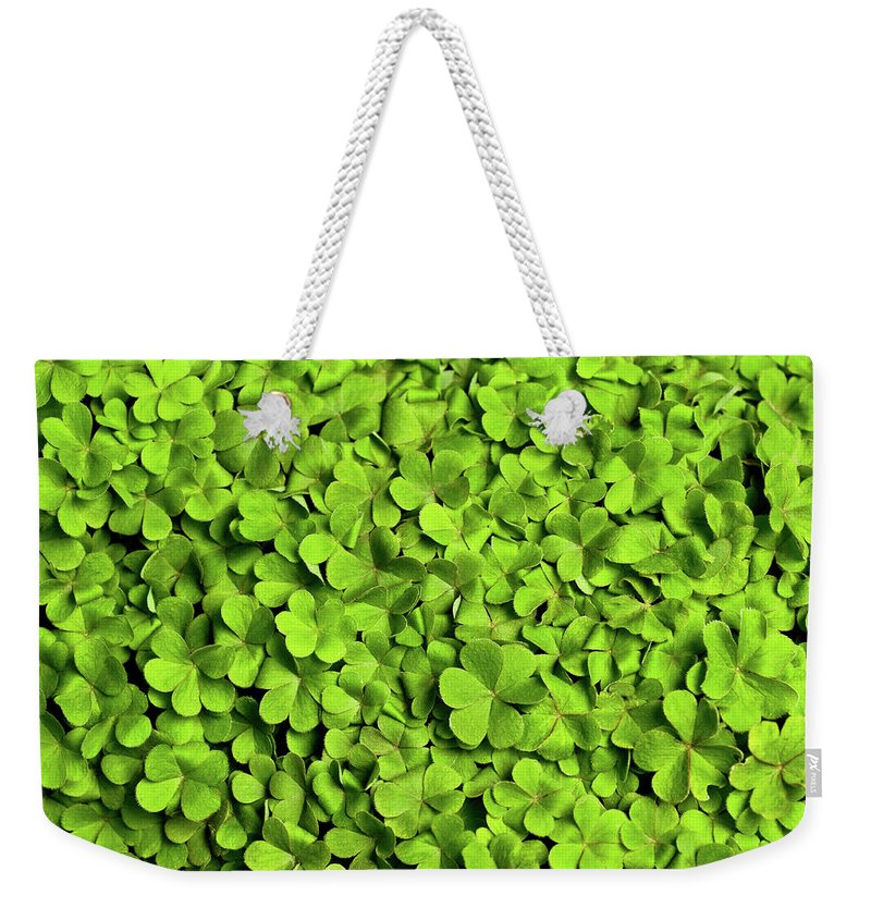 Leaf Weekender Tote Bag featuring the photograph Bed Of Clover by Kledge