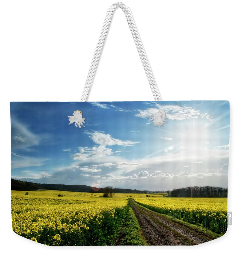 Tranquility Weekender Tote Bag featuring the photograph Belvoir Fields by Petertowle