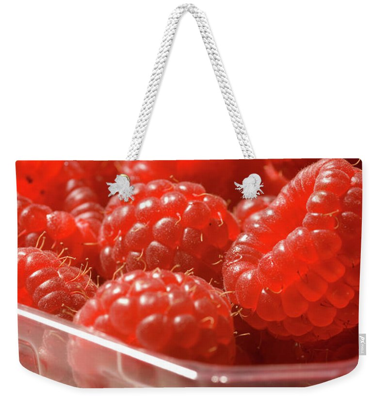 Lifestyles Weekender Tote Bag featuring the photograph Berries In Carton by Gwmullis