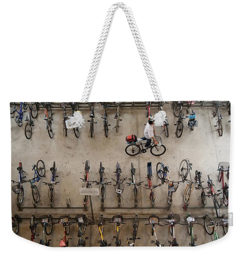People Weekender Tote Bag featuring the photograph Bicycle Park At Boon Lay Mrt Station by Kokkai Ng