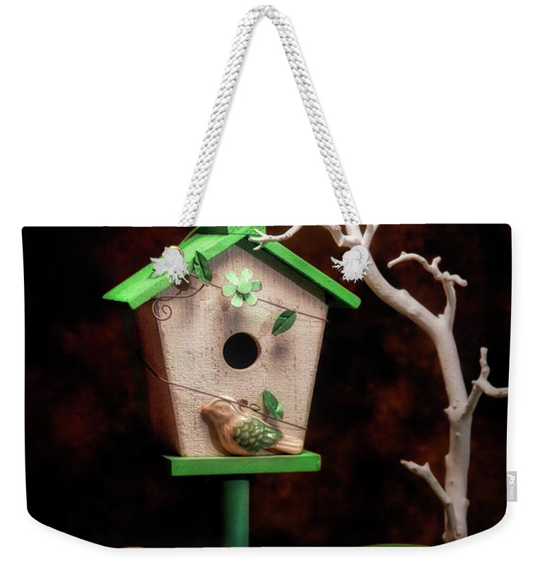 Birdhouse Weekender Tote Bag featuring the photograph Birdhouse With Tulips by Tom Mc Nemar