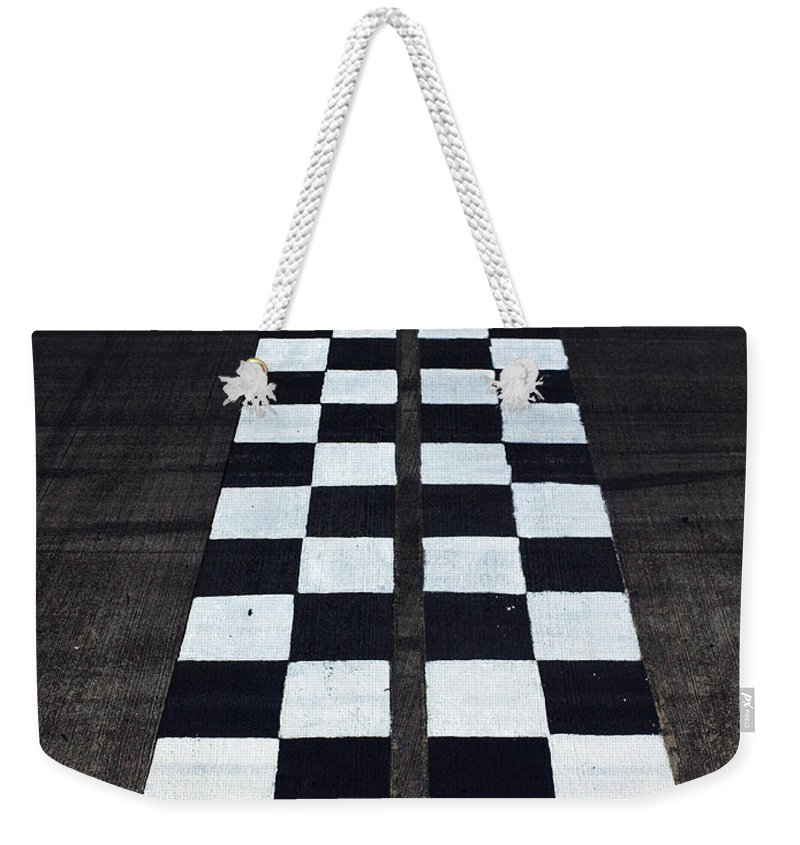 Finish Line Weekender Tote Bag featuring the photograph Black And White Finish Line by Win-initiative/neleman