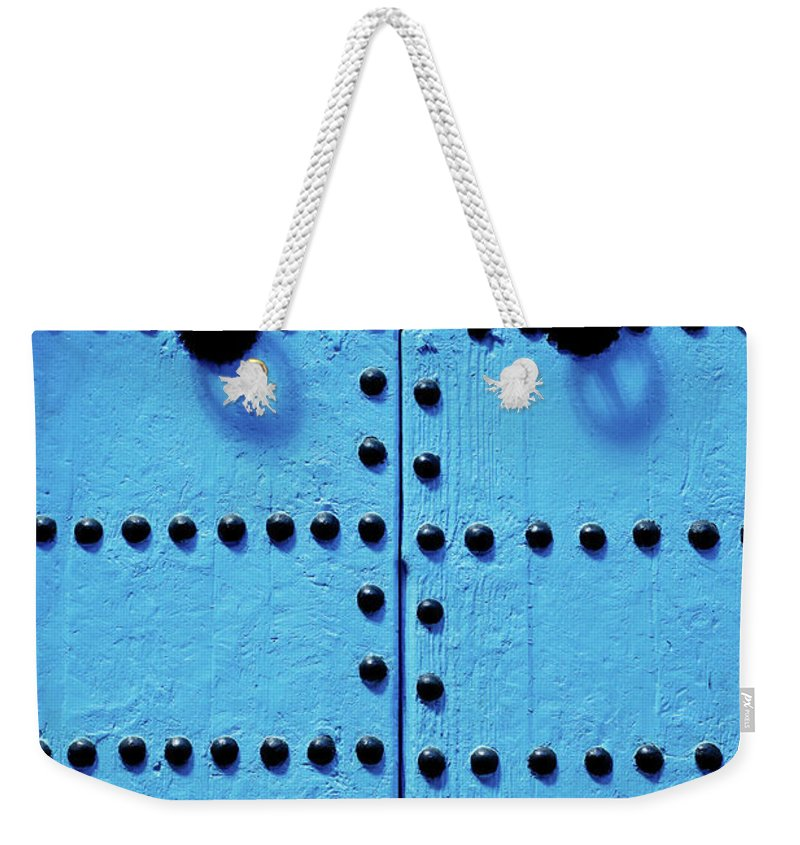 Shadow Weekender Tote Bag featuring the photograph Blue Moroccan Door by Kelly Cheng Travel Photography