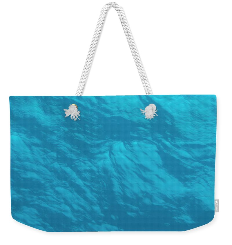 Tranquility Weekender Tote Bag featuring the photograph Blue Ocean Water Surface As Seen From by Jeff Hunter
