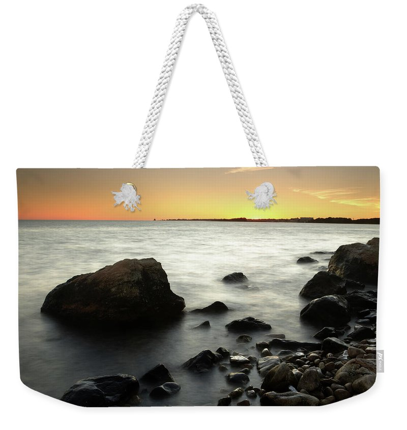 Water's Edge Weekender Tote Bag featuring the photograph Bluff Point Sunset by Ericfoltz