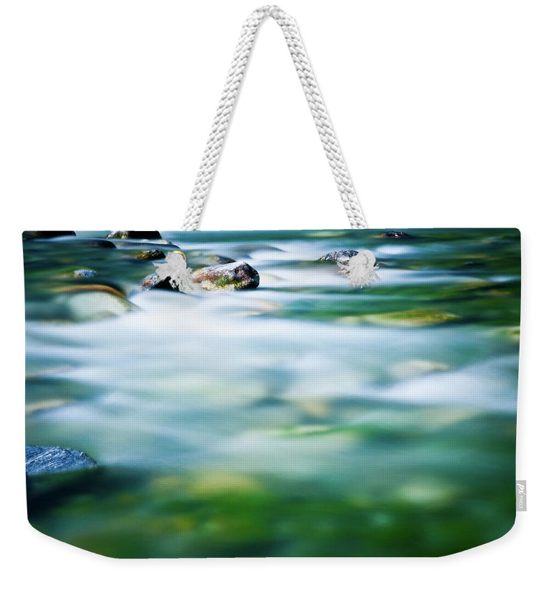 Scenics Weekender Tote Bag featuring the photograph Blurred River by Assalve
