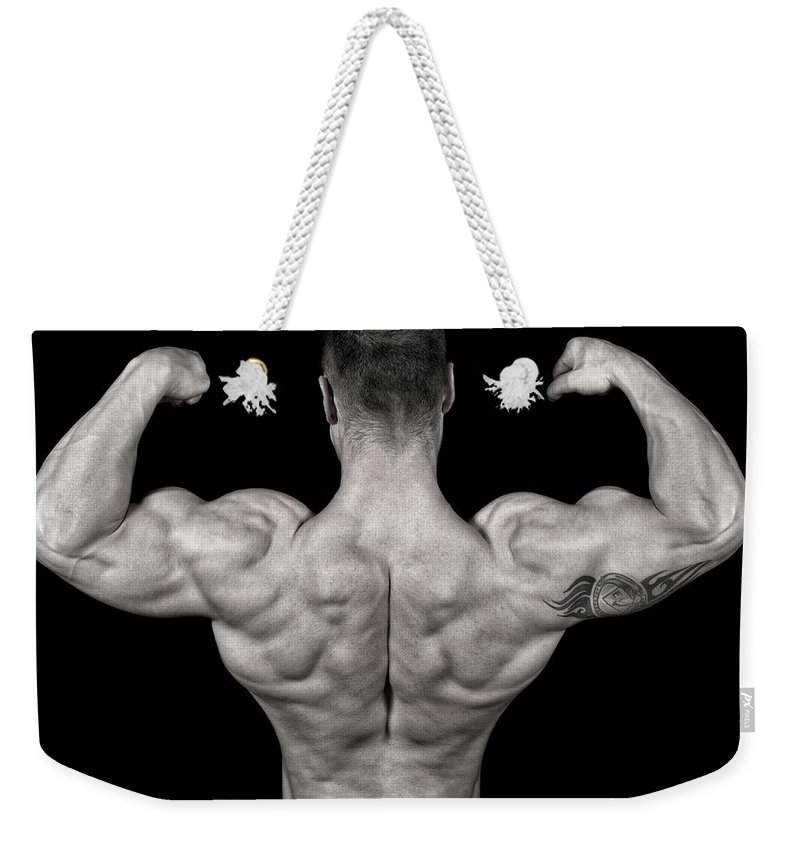 Toughness Weekender Tote Bag featuring the photograph Bodybuilder Posing by Vuk8691