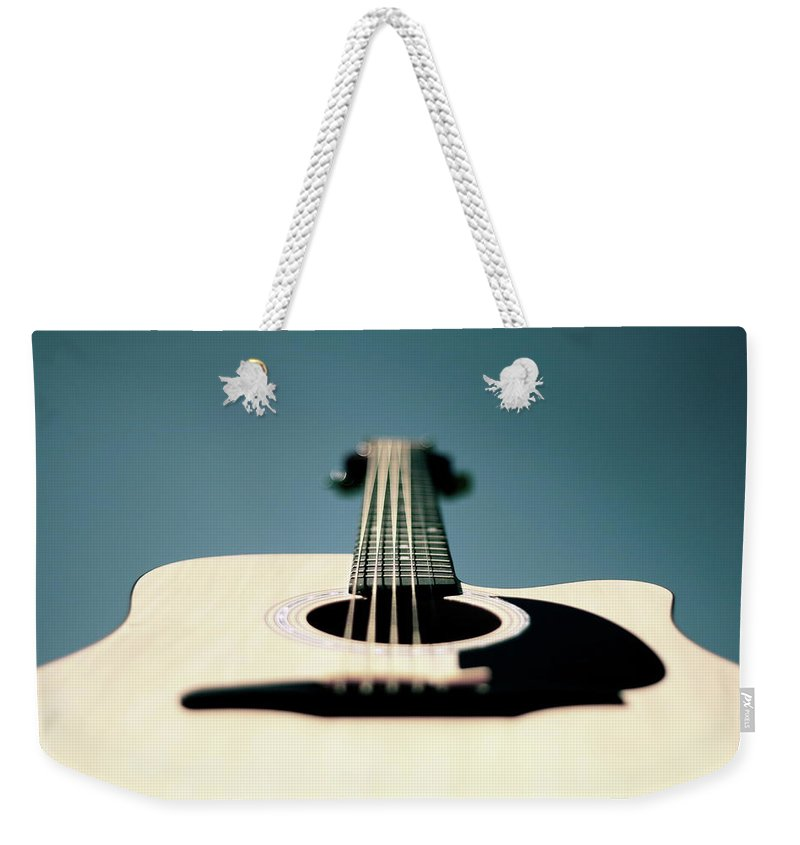 Music Weekender Tote Bag featuring the photograph Bokeh String by George Bentley Photography