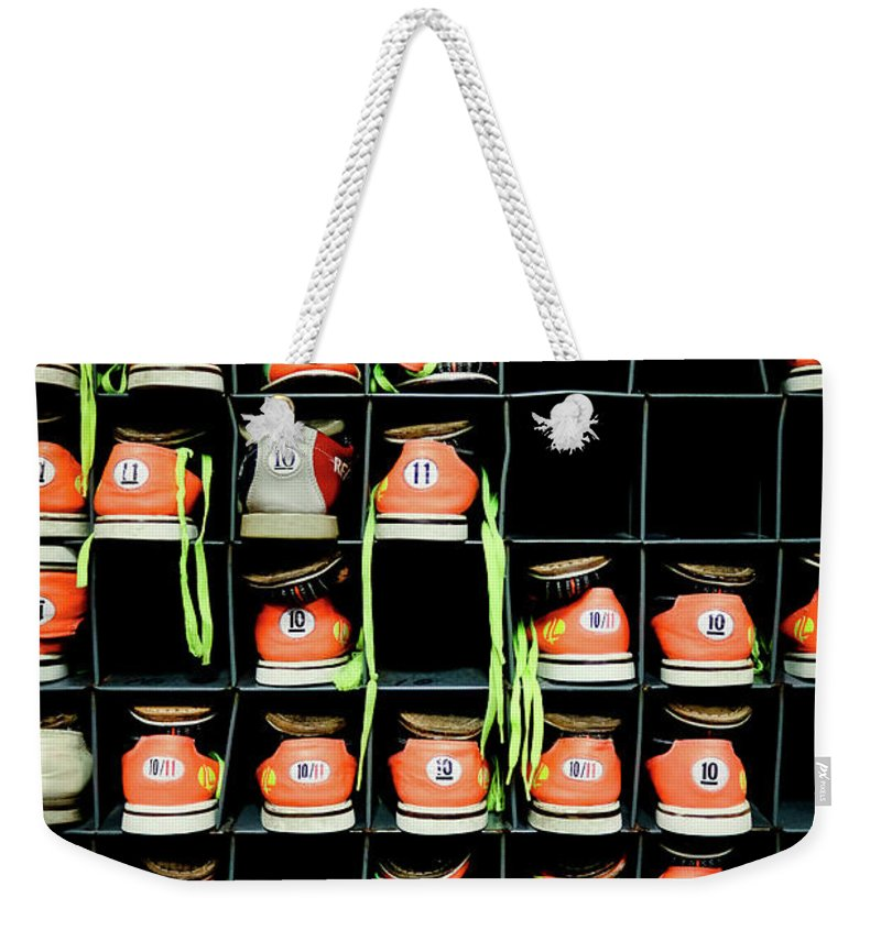Orange Color Weekender Tote Bag featuring the photograph Bowling Shoes by Christian Bird