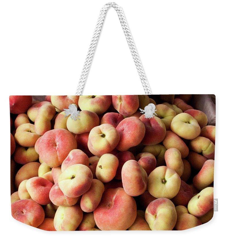 Retail Weekender Tote Bag featuring the photograph Box Of Donut Peaches At A Farmers Market by Bill Boch