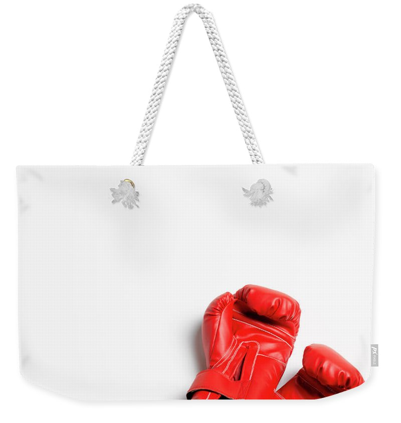 The End Weekender Tote Bag featuring the photograph Boxing Gloves On White Background by Peter Dazeley
