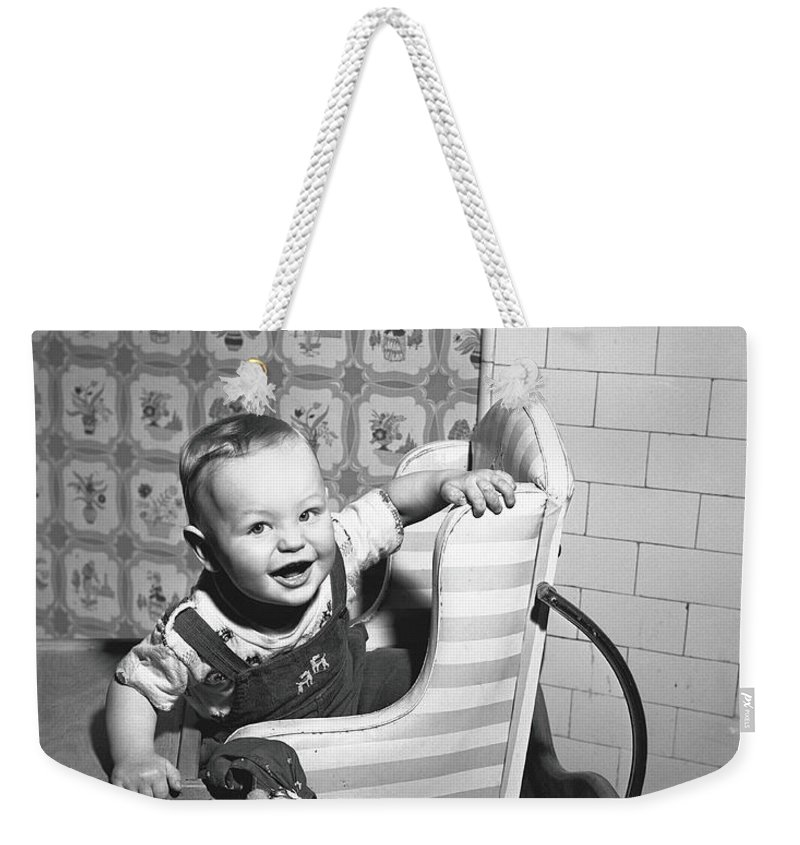Child Weekender Tote Bag featuring the photograph Boy 2-3 Sitting In High Chair, B&w by George Marks