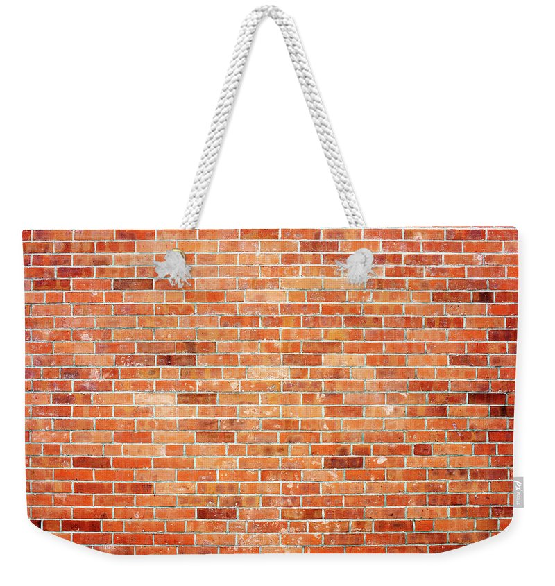 Toughness Weekender Tote Bag featuring the photograph Brick Wall by Ballyscanlon