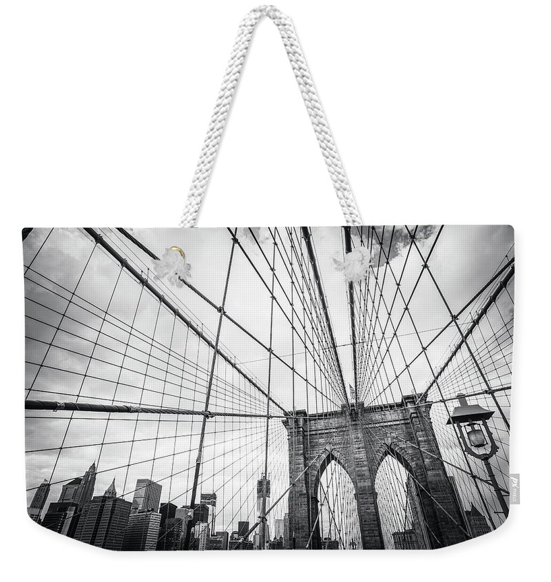 Downtown District Weekender Tote Bag featuring the photograph Brooklyn Bridge And New York Skyline by Cirano83