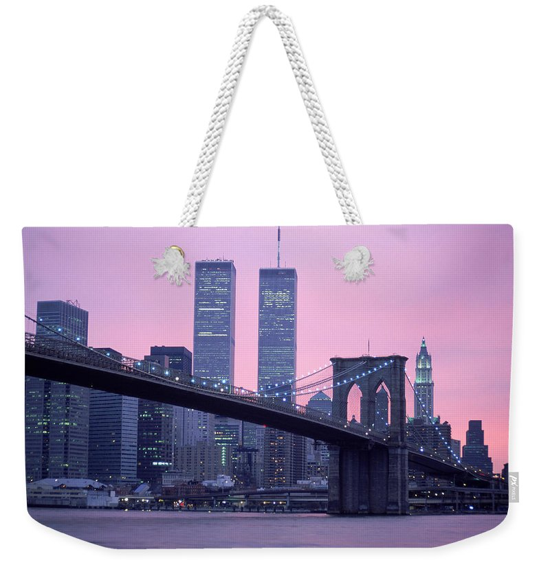 Dawn Weekender Tote Bag featuring the photograph Brooklyn Bridge, Twin Towers, Nyc, Ny by Barry Winiker