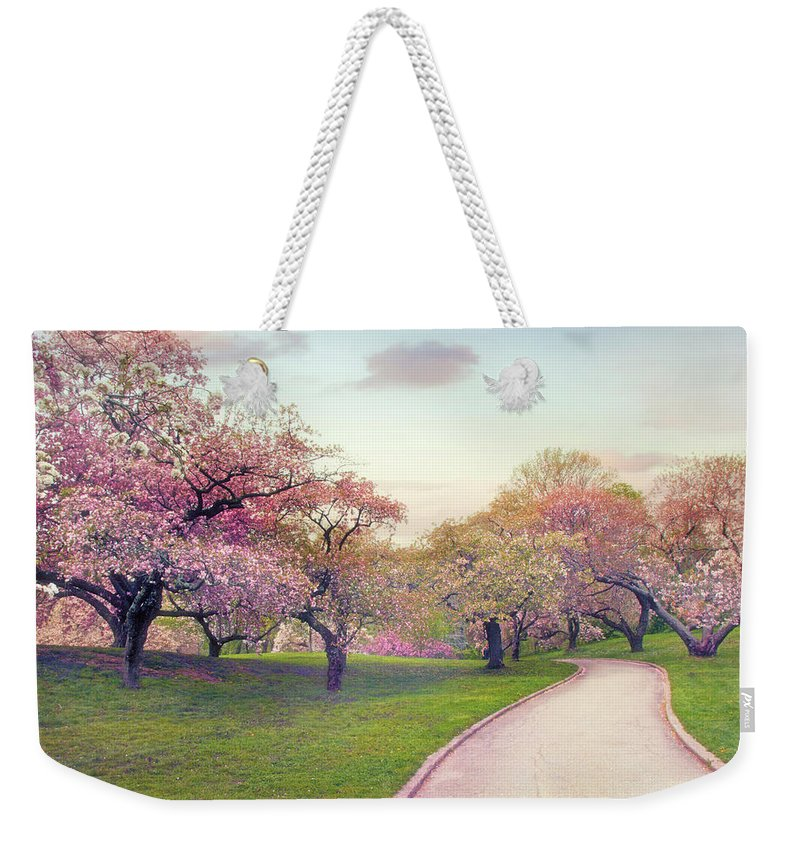Cherry Grove Weekender Tote Bag featuring the photograph The Cherry Path by Jessica Jenney