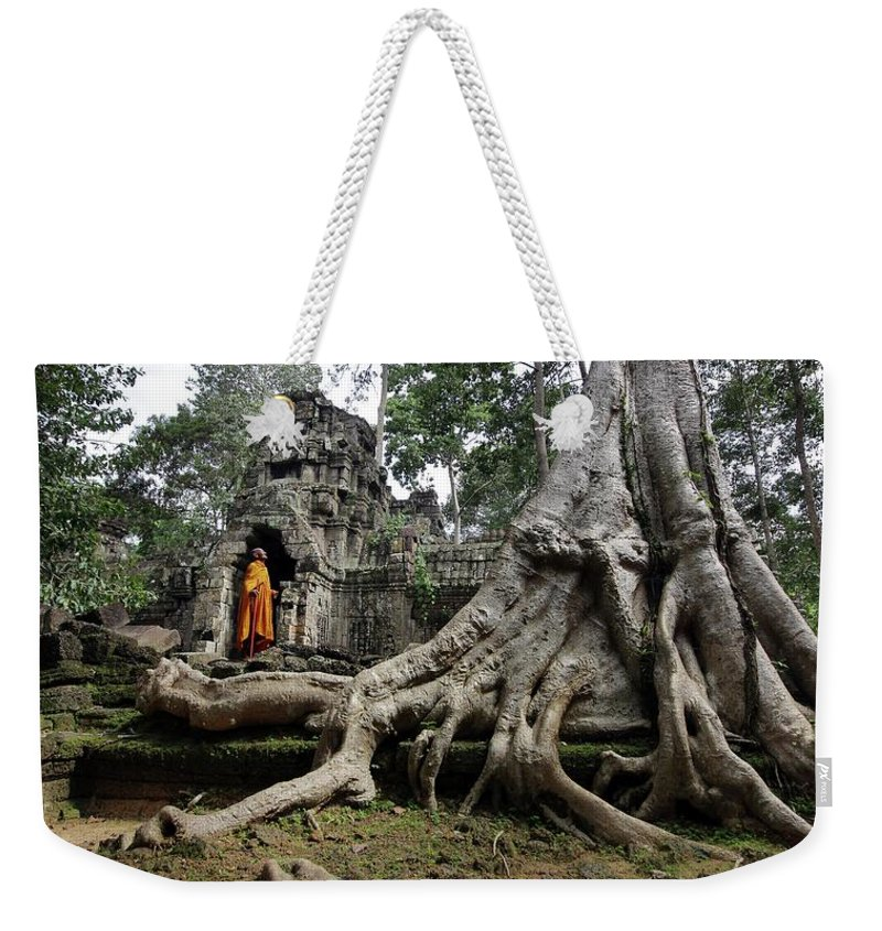 Orange Color Weekender Tote Bag featuring the photograph Buddhist Monk At Angkor Wat Temple by Timothy Allen