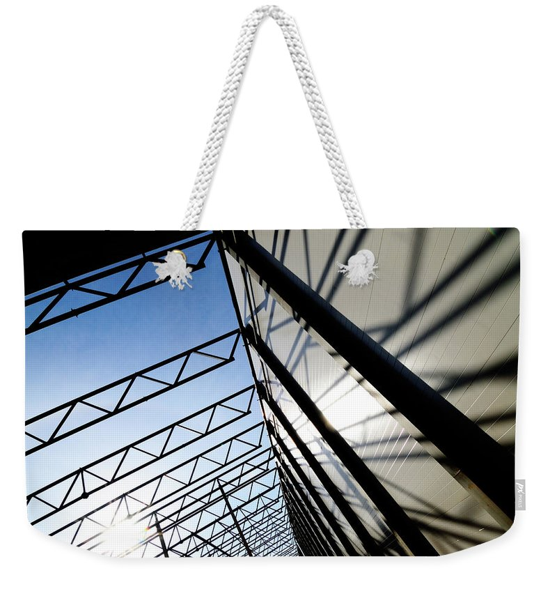 Shadow Weekender Tote Bag featuring the photograph Building Abstract by Maximgostev