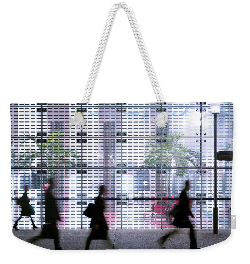 People Weekender Tote Bag featuring the photograph Business People Passing Modern Office by Eschcollection