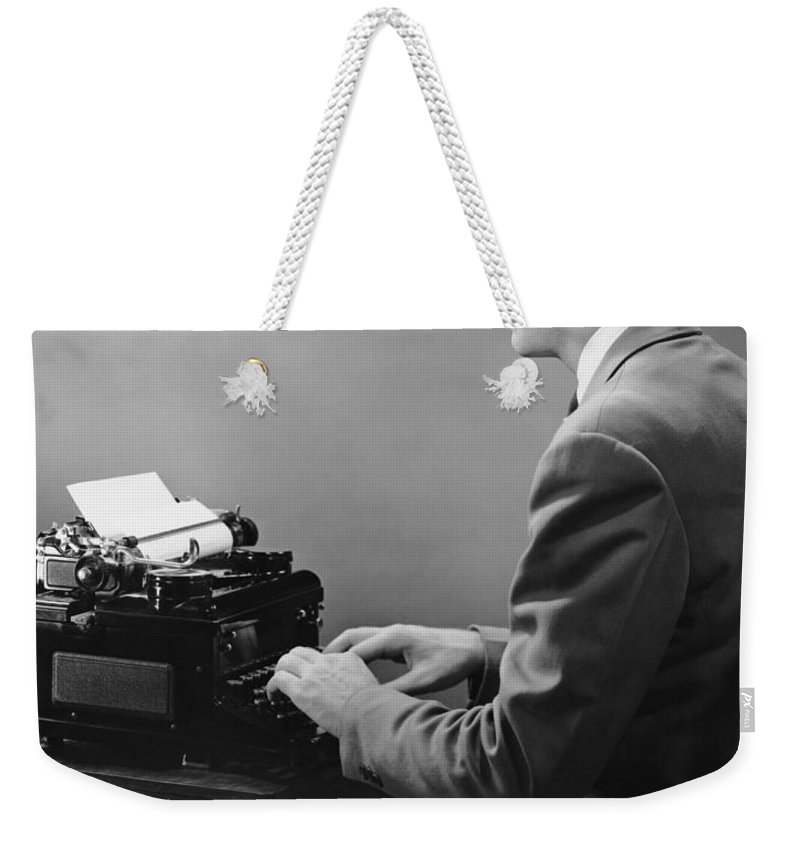 Three Quarter Length Weekender Tote Bag featuring the photograph Businessman Inside Office Typing by George Marks