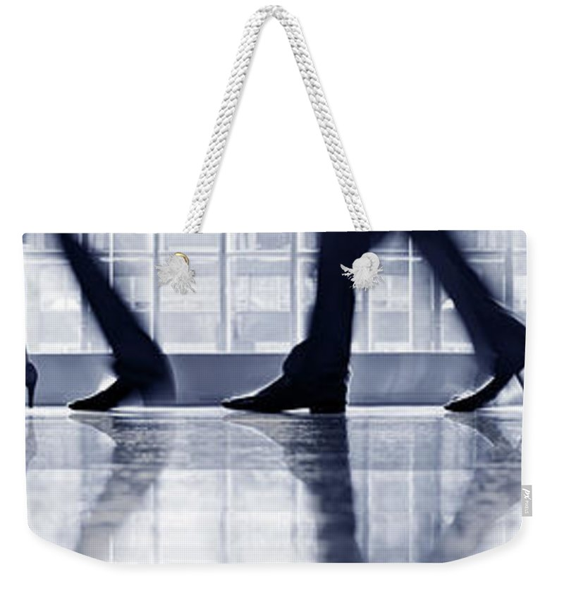 Corporate Business Weekender Tote Bag featuring the photograph Businesspeople Walking In Lobby, Low by Poba