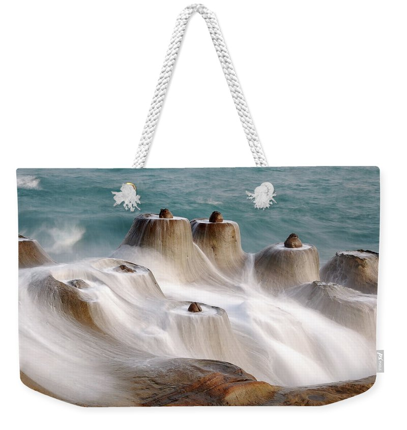 Taiwan Weekender Tote Bag featuring the photograph Candle Shaped Rock by Maxchu