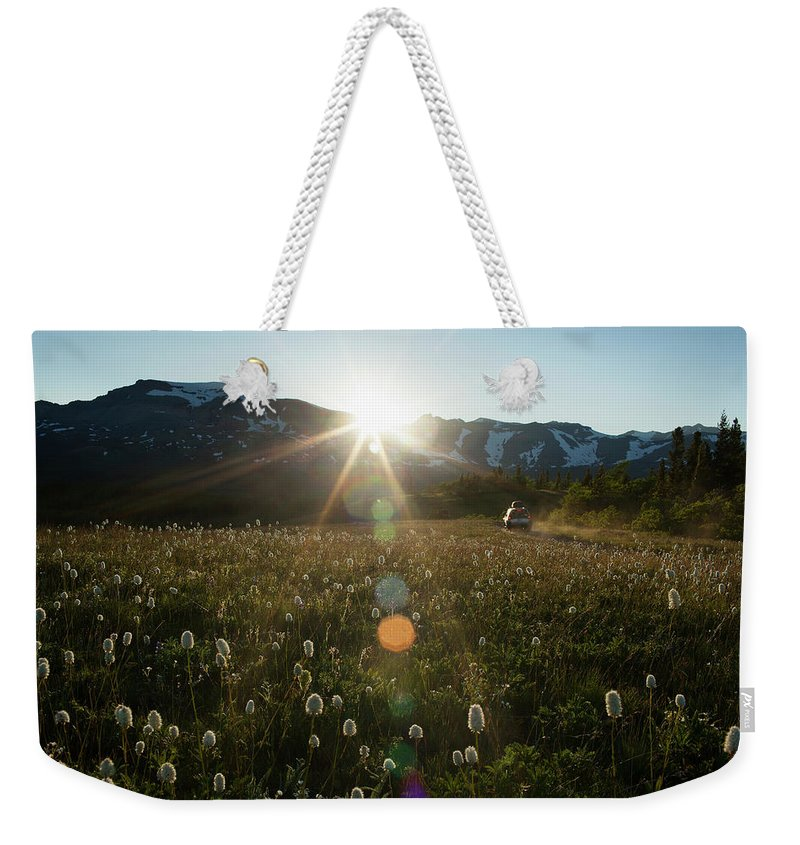 Scenics Weekender Tote Bag featuring the photograph Car On Rural Dirt Road In Mountains At by Noah Clayton