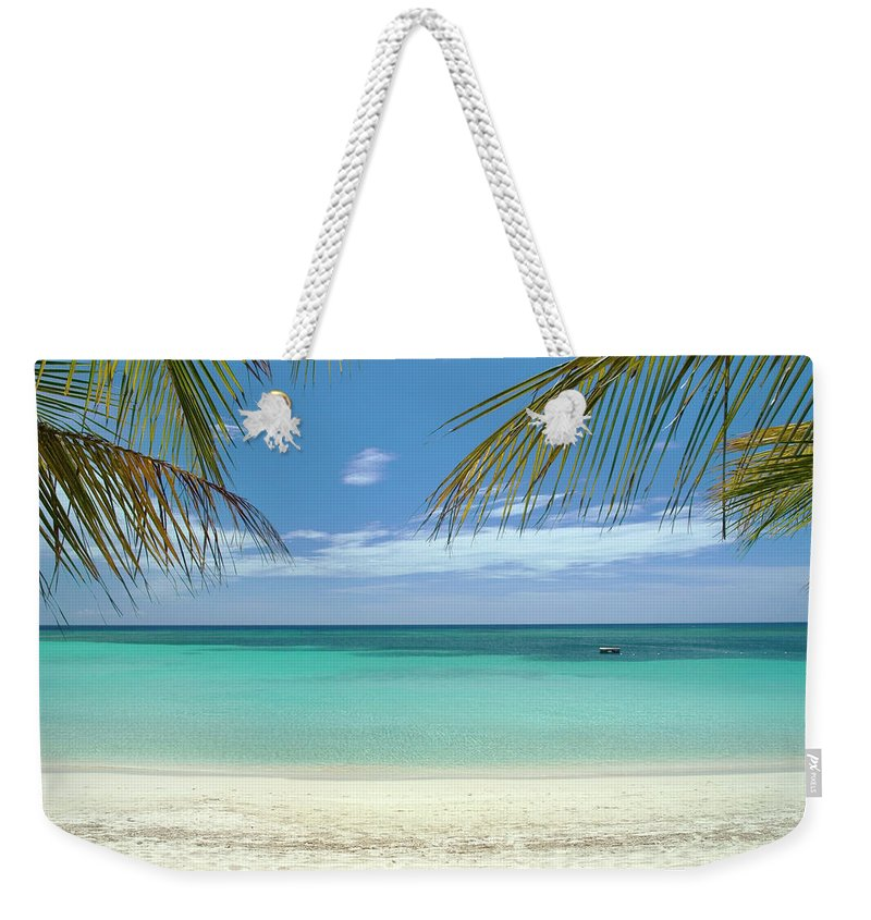 Cool Attitude Weekender Tote Bag featuring the photograph Caribbean Sea And White Sand Beach by Digi guru